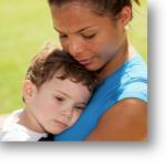woman holding a little boy