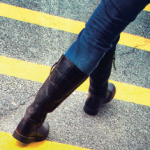 woman walking across road