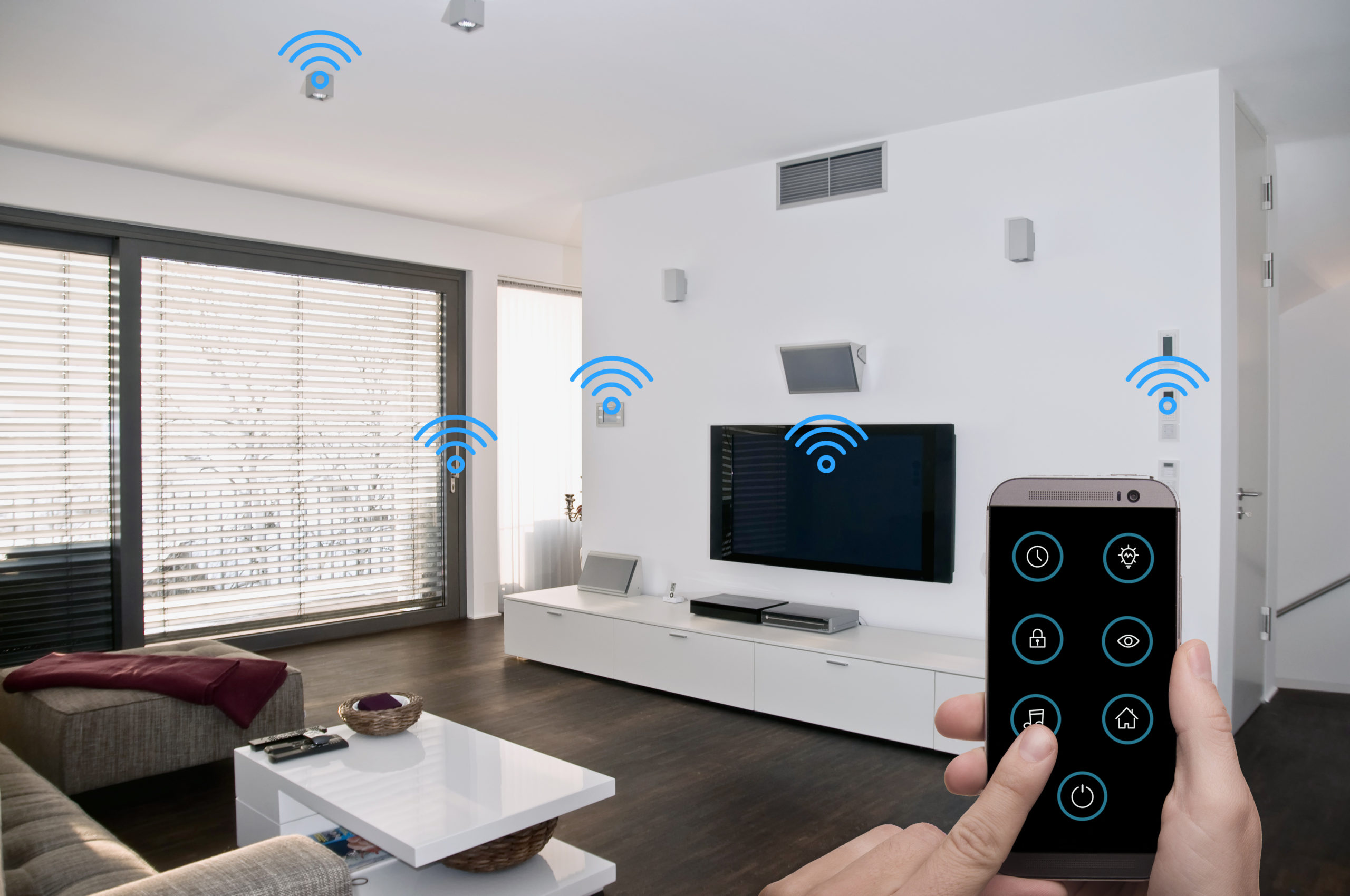 Mans hand with device and smart home